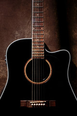 Detail of black acoustic guitar