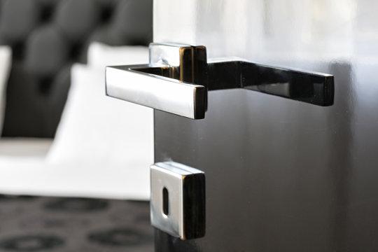 Chrome door knob on black door