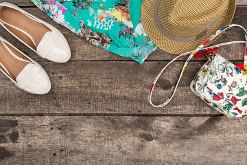 Woman summer clothes and accessories on old wooden background