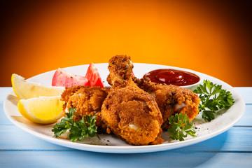 Roast chicken drumsticks and vegetables