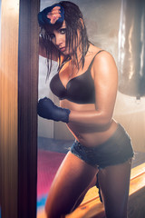 Sexy brunette fitness wet woman after workout