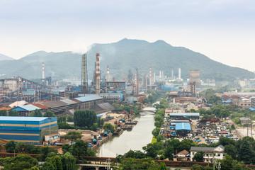 Steel mills hazy smoke pollution in industrial area