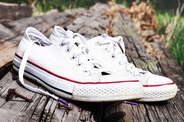 White canvas shoes on a wood