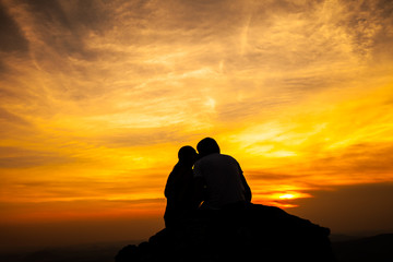 Silhouette of loving couple in sunset