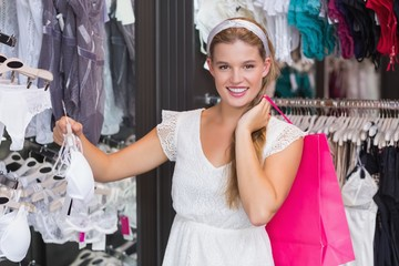 Pretty woman buying sexy lingerie