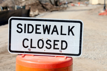 Sidewalk closed sign in front of a construction zone