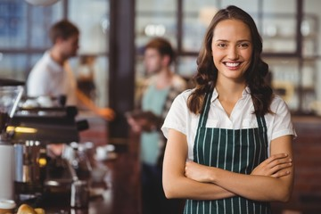 Pretty barista with arms crossed