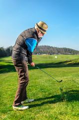 Senior citizen is playing golf