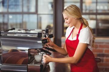A pretty barista preparing coffee