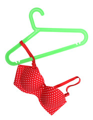 Hanging red bra isolated on white background