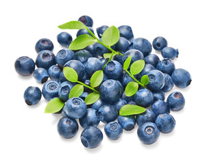 Fresh blueberries with green leaves