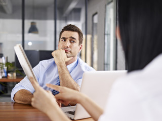 skeptical interviewer looking at interviewee