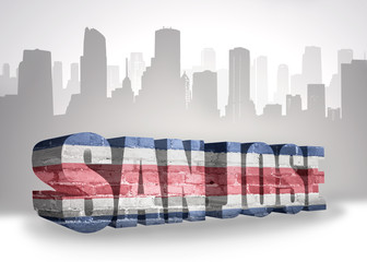 text san jose with national flag of costa rica near abstract silhouette of the city