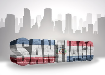 text santiago with national flag of dominican republic near abstract silhouette of the city