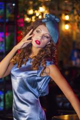 Stylish young woman in a nightclub