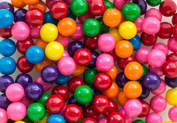 horizontal image of a background shot of colourful  array of bubble gum filling the whole composition