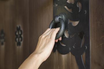 hand holding a door knocker