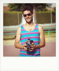 Instant photo of young man with old film camera
