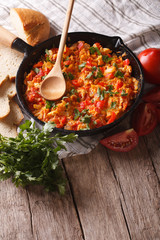Turkish Menemen fried with vegetables close-up vertical