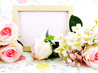 wood frame ande pink roses with red velvet box on sweet background