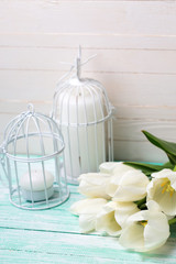 Background  with fresh spring white flowers and candles