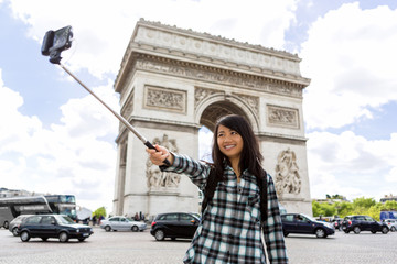 Young attractive asian tourist in Paris taking selfie