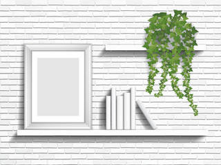 Books and houseplant on white shelves on brick wall background