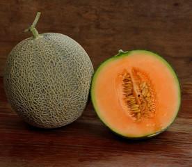 Fresh melon on wooden background.