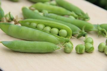 Green peas on chopping board