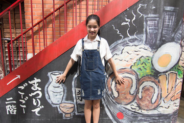 Portrait of thai student teen beautiful girl relax and smile.