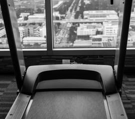 Tread mill in gym  black and white