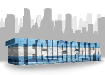 text tegucigalpa with national flag of honduras near abstract silhouette of the city