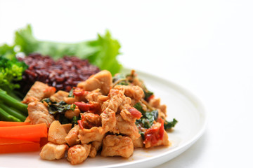 rice topped with stir-fried chicken and basil, one of clean food
