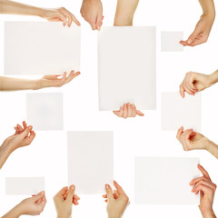 Hands holding blank cards isolated on white