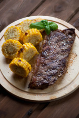 Grilled black angus steak striploin served with sweet corn