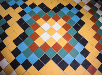 colorful tile floor pattern in hallway of Benedictine Abbey done in Art Deco style