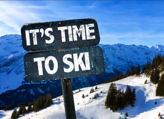 Fototapeta Its Time To Ski sign with sky background obraz