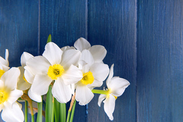 Beautiful bouquet of daffodils on wooden background