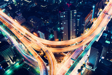 Spoed Fotobehang Nacht snelweg Aerial-view highway junction at night in Tokyo, Japan