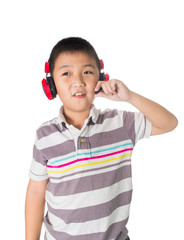 Asian boy listening music with headphones, isolated on white bac