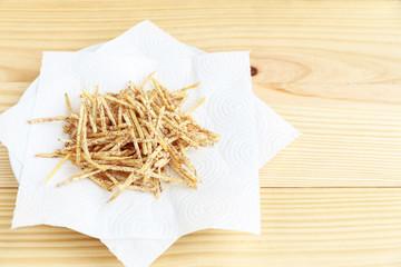 Fried taro in the dish on wood