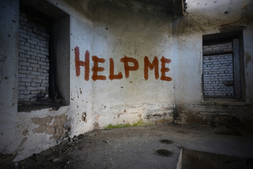 text help me on the dirty old wall in an abandoned ruined house