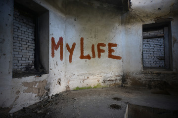 text my life on the dirty old wall in an abandoned ruined house