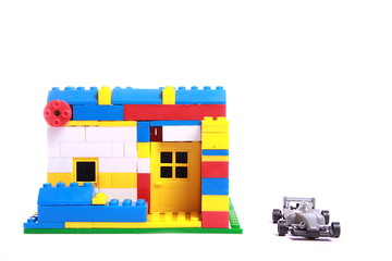 bBungalow structure built using building block with toy car