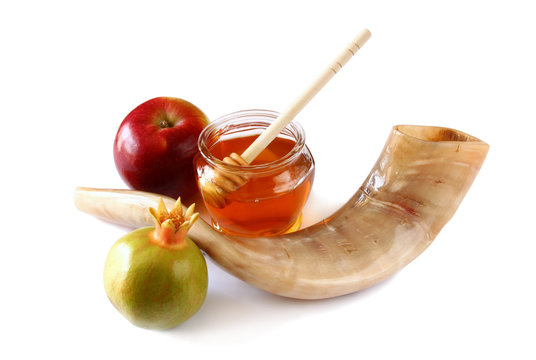 rosh hashanah (jewesh holiday) concept - shofar (horn), honey