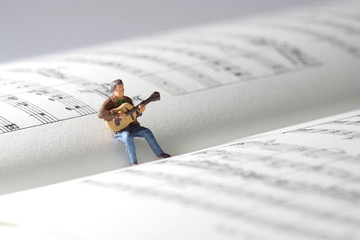 Miniature guitarist music book.