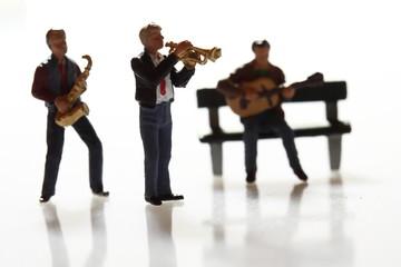 Miniature musicians. Miniature scale model musicians performing.