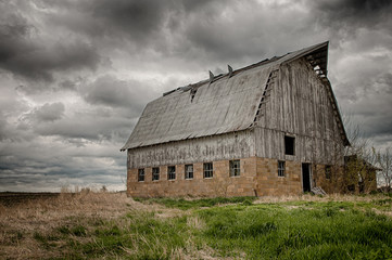 Stormy barn.  Old barn on prairie with stormy sky, USA