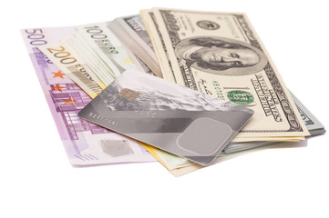 credit card with euro and dollar banknotes