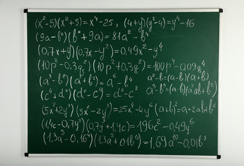 Math formulas on blackboard background